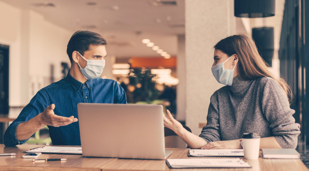 coworking space and people with masks